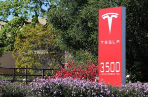 Palo Alto, California, USA – March 18, 2014: The Tesla Motors World Headquarters in Palo Alto. Tesla Motors is an American company that designs, manufactures and sells electric cars and related components.